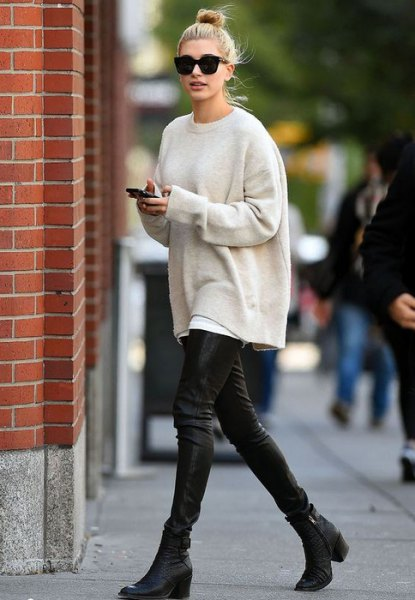 off white oversized knit sweater with black leather leggings