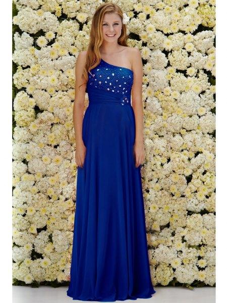 one shoulder royal blue formal dress with open toe white heels