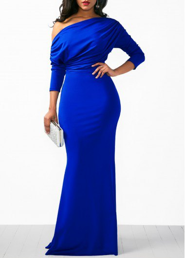 one shoulder royal blue long sleeve dress with white clutch purse