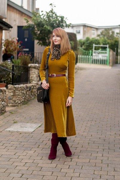 orange belted long sleeve velvet midi dress with boots