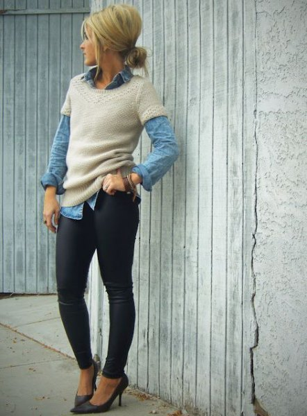 pale pink short sleeve sweater over blue chambray button up shirt
