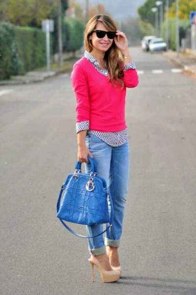 pink knit sweater with black and white polka dot shirt and cuffed jeans