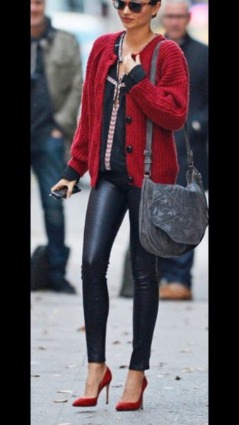 red ribbed cardigan sweater with black leather skinny pants
