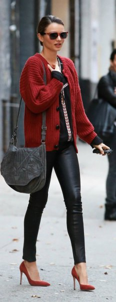 red ribbed sweater cardigan with black top and leather leggings