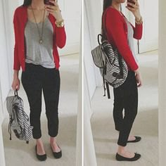 red sweater with grey scoop neck tee and black cropped jeans