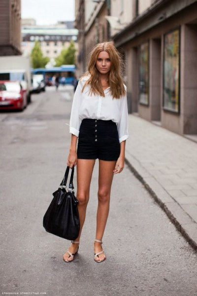 white button up shirt with black button front high rise denim shorts