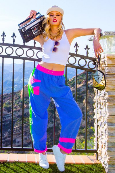 white cropped tank top with royal blue and pink windbreaker pants