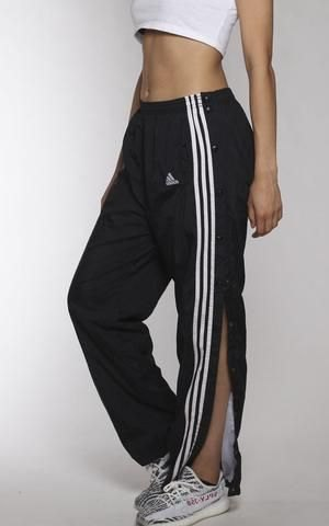 white cropped tee with black side slit running pants