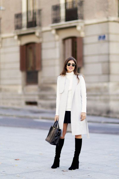 white long cardigan with mock neck sweater and mini skirt