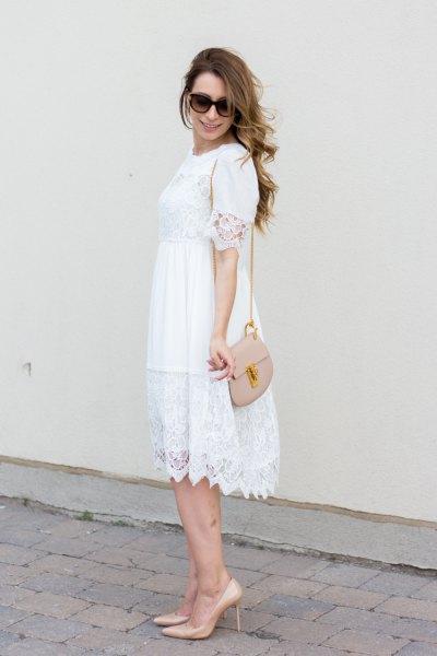 white scalloped hem babydoll midi dress with pale pink shoulder bag