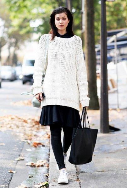 white tunic sweater with black mini skater skirt