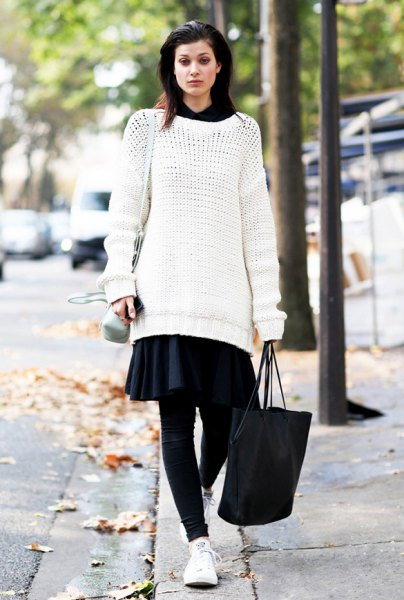white tunic sweater with black mini skater skirt