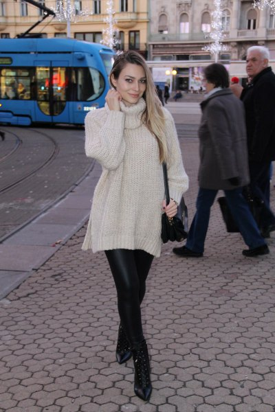 white turtleneck knit sweater with black leather leggings