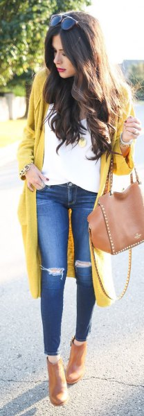 yellow longline cardigan sweater with white blouse and ripped knee jeans