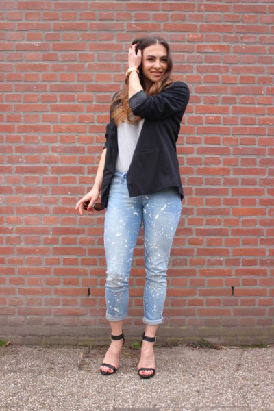 black blazer with white tee and light blue cuffed painted jeans