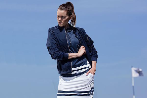 black bomber golf jacket with white mini shift skirt