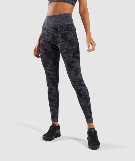 black crop top with grey printed leggings and sneakers