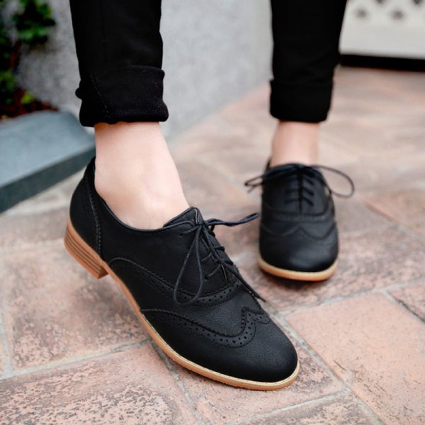 black cuffed skinny jeans and matching suede oxford shoes