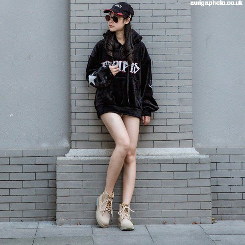 black hoodie dress with light brown shoes and baseball cap