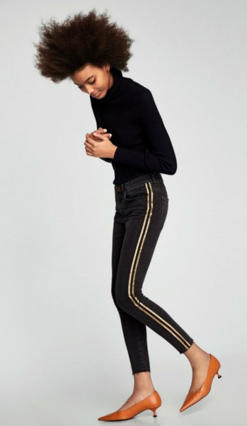 black knit sweater with skinny striped jeans and gold kitten heels