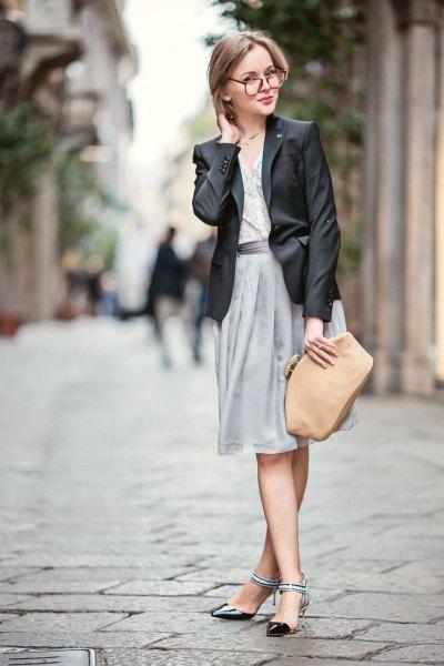 black leather jacket with chiffon grey skirt and blush purse
