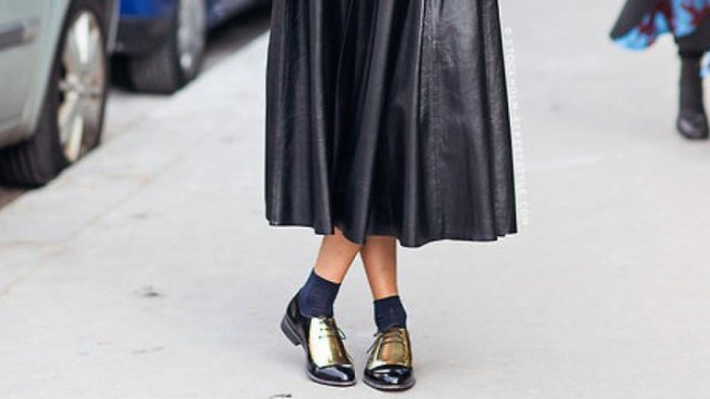 black leather pleated maxi dress with grey crew socks and gold derby shoes