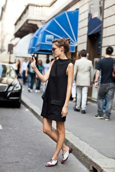 black mock neck mini shift dress with white and grey oxford dress shoes