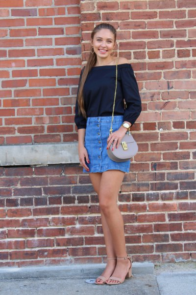 black off the shoulder blouse with blue high rise mini denim skirt