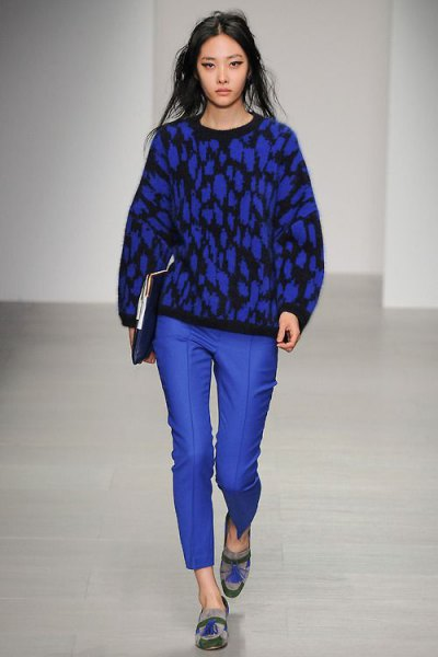 black printed knit sweater with royal blue waxed pants and graphic dress shoes