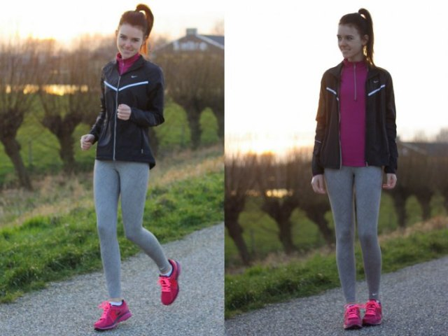black running windbreaker with grey leggings and pink sneakers