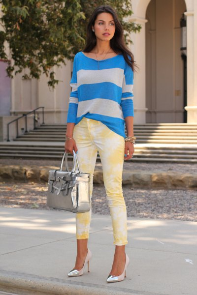 blue and grey striped sweater with yellow printed skinny jeans