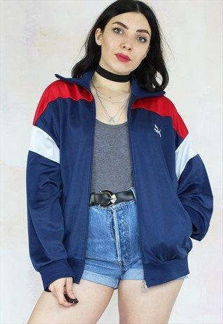 blue and red vintage windbreaker with denim high waisted shorts