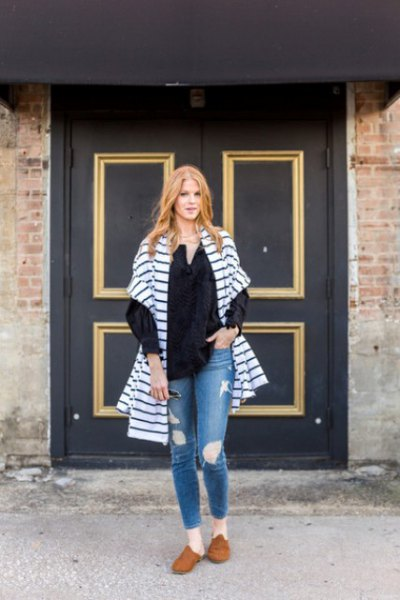 blue and white striped oversized cardigan with ripped jeans and brown suede dress shoes