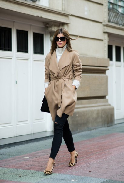 blush pink belted wool coat with black skinny jeans