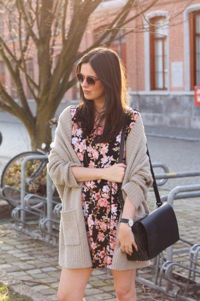 blush pink knit cardigan with black floral mini shift dress