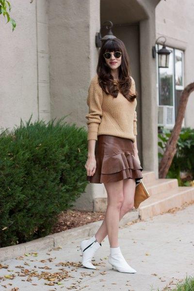 blush ribbed knit sweater with grey mini ruffle skirt