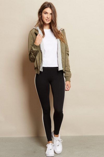brown fleece jacket with black leggings and white sneakers