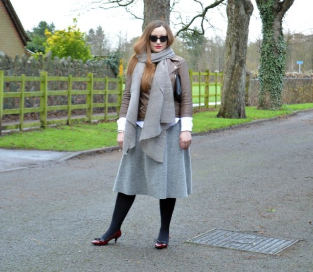 brown leather jacket with grey wool scarf and matching midi skirt
