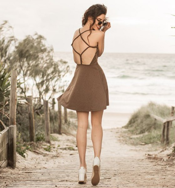 brown open back fit and flare mini dress with white platform heels