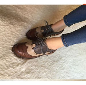 brown wingtips shoes with dark ankle skinny jeans
