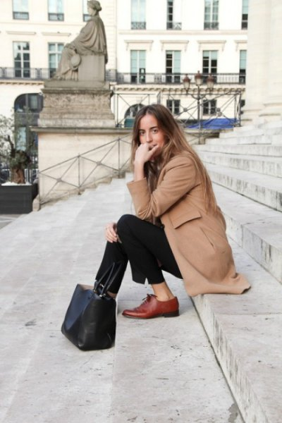 camel long wool coat with black chinos and brown dress shoes