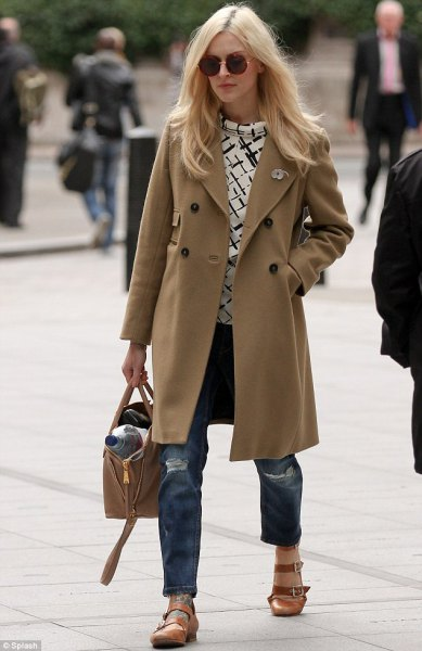 camel long wool coat with ripped boyfriend jeans and rounded toe light brown dress shoes