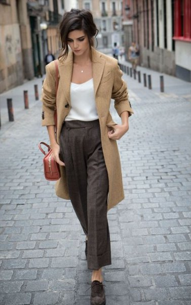camel longline wool coat with white vest top and grey wide leg pants