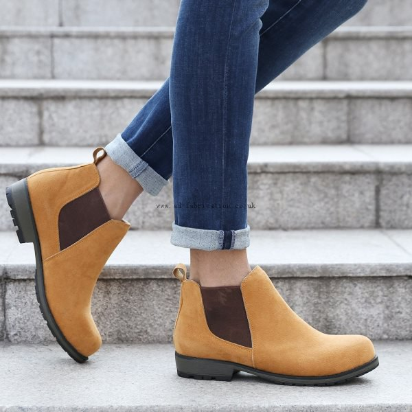 dark blue cuffed skinny jeans with light brown suede dress shoes