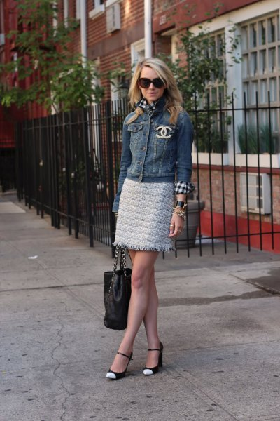 denim jacket with mini skirt and white and black cap toe shoes