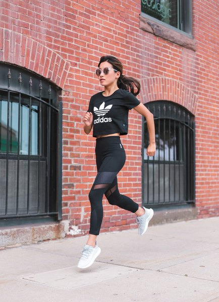 graphic cropped tee with running tights and white running shoes