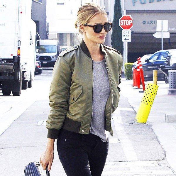 green cropped bomber jacket with grey tee and skinny jeans