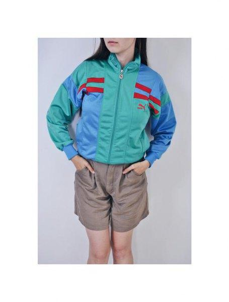 grey and light blue puma windbreaker with light green mini flowy shorts