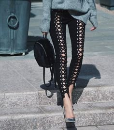 grey knit sweater with black lace up skinny jeans