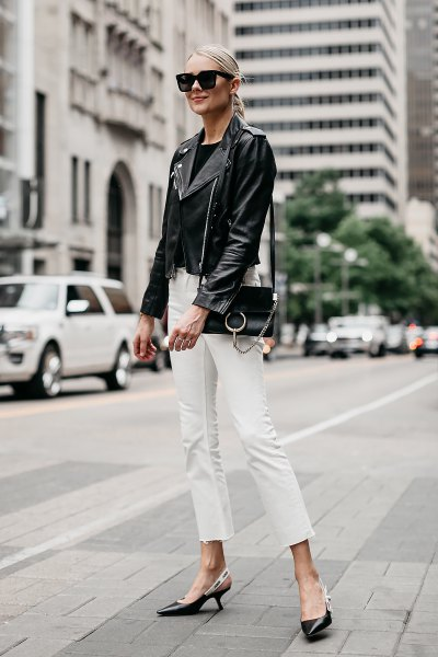 leather jacket with white cropped slim fit jeans